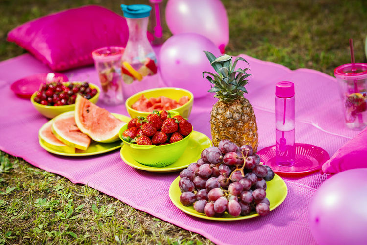 Picnic Food Forest Food And Drink Healthy Eating Table Plate Fruit No People Pink Color Meal Glass Grape Wellbeing Household Equipment Tablecloth Drinking Glass Drink Meat Candle Front Or Back Yard Celebration Setting