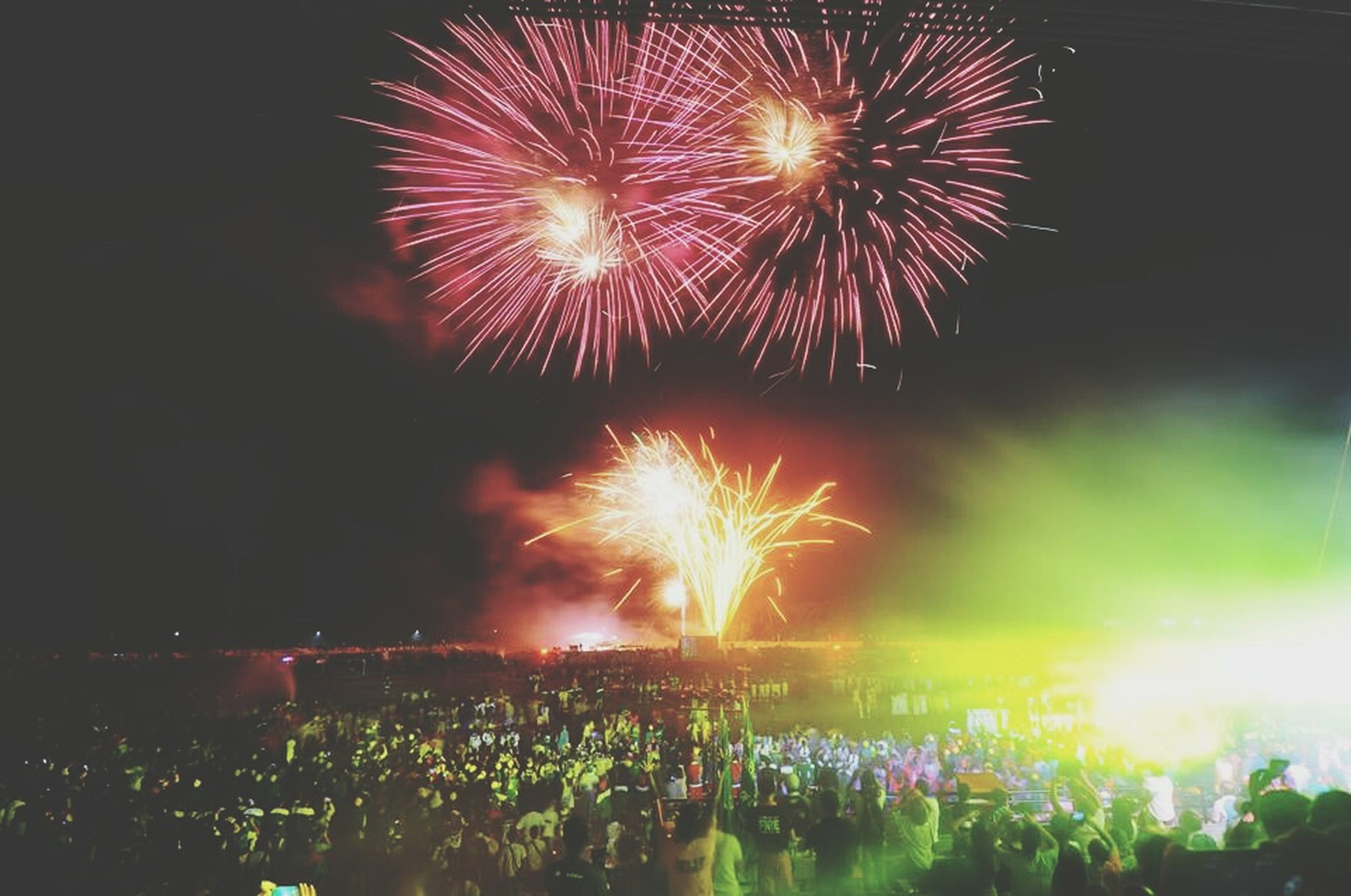 illuminated, night, firework display, celebration, exploding, firework - man made object, long exposure, glowing, event, arts culture and entertainment, motion, sparks, firework, entertainment, blurred motion, multi colored, celebration event, sky, fire - natural phenomenon, low angle view