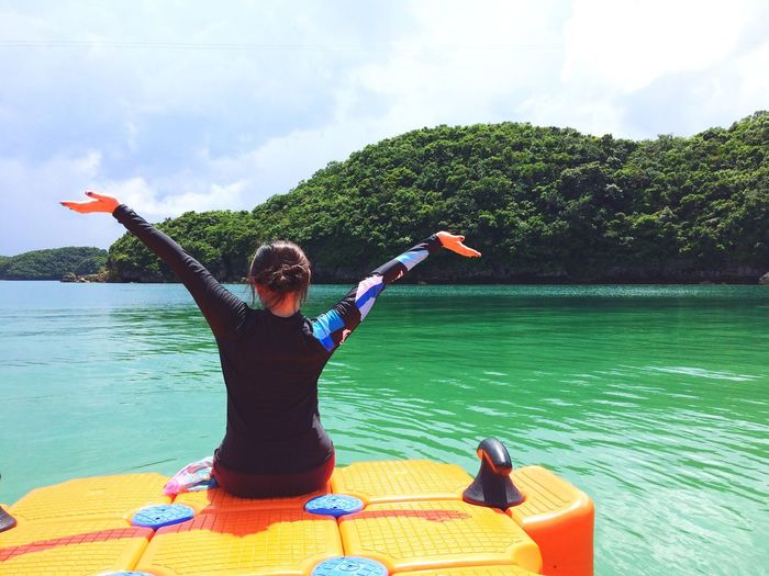 Nature islands Leisure Activity summer Summer Water Young Women Arms Outstretched Lake Lifestyles Casual Clothing Cloud - Sky Vacations Sky Day Tranquility Fun
