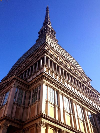 Low angle view of la mole antonelliana against clear sky