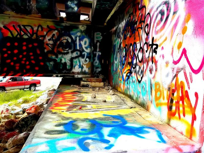 Takingovercontrast People And Places Art And Craft Graffiti Multi Colored Art Creativity The Way Forward Street Art Colorful City Life Tranquil Scene No People Selective Focus Architecture TakeoverContrast Illuminated Orange Color - THIS WAS TAKENunderneath GRAFFITI BRIDGE IN PENSACOLA, FLORIDA. HOMELESS CITIZENS PAINT THIS BRIDGE !! My Year My View