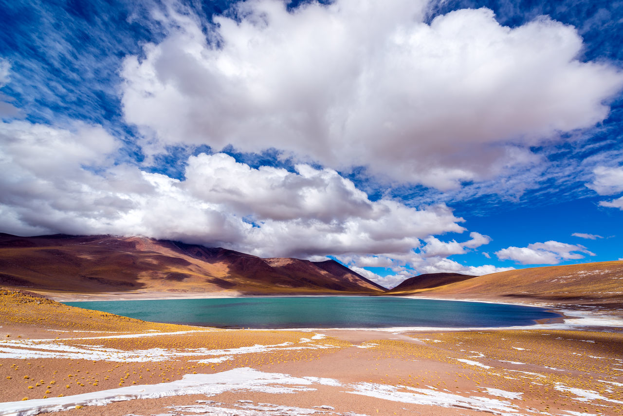 Blue Lake Meniques in the high plans of northern Chile near San Pedro de Atacama Altiplano Andean Atacama Atacama Desert Chile Colorful Desert High Lagoon Lake Landscape Miscanti Miscanti Lake Mountains National Park Nature Park Red Salt San Pedro De Atacama Sand South America Tourism Volcano Water