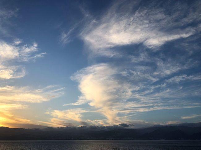 Sky Cloud - Sky Beauty In Nature Scenics - Nature Tranquility Tranquil Scene Water Nature No People Idyllic Waterfront Sunset Sea Outdoors Non-urban Scene Sunlight Day Dusk Wolkenhimmel Wolkenbilder Abendstimmung Sonnenuntergang Himmel Und Wolken Wasserspiegelung Berge Und Meer