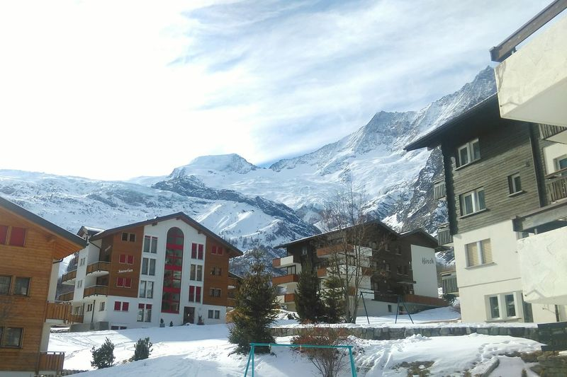 Snow Winter Building Exterior Cold Temperature House Architecture Outdoors Sky No People Nature Mountain Travel Destinations Cloud - Sky Saasfee Switzerland Snowy Mountains Swiss Mountains Architecture Winter Built Structure Day