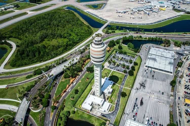 Aerial view of air traffic control tower in city