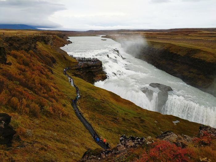 Gullfoss Gullfoss Waterfall Gullfoss Falls Incidental People Iceland Hiking Path Hiking Travel Destinations Travel In Iceland Golden Circle Vast Landscape Beauty In Nature Landmark Fall Fall Colors September Mountain Silhouette Cliff View From Above Icelandic Landscape Waterfall Weather Climate Water Power In Nature Motion Sea Sky Landscape Cloud - Sky