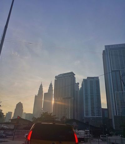 morning! Morning Kuala Lumpur Malaysia  Sunrise Building Shadow Skyscraper Architecture Outdoors City Travel Destinations No People Day Sky Cityscape Urban Skyline Building Exterior