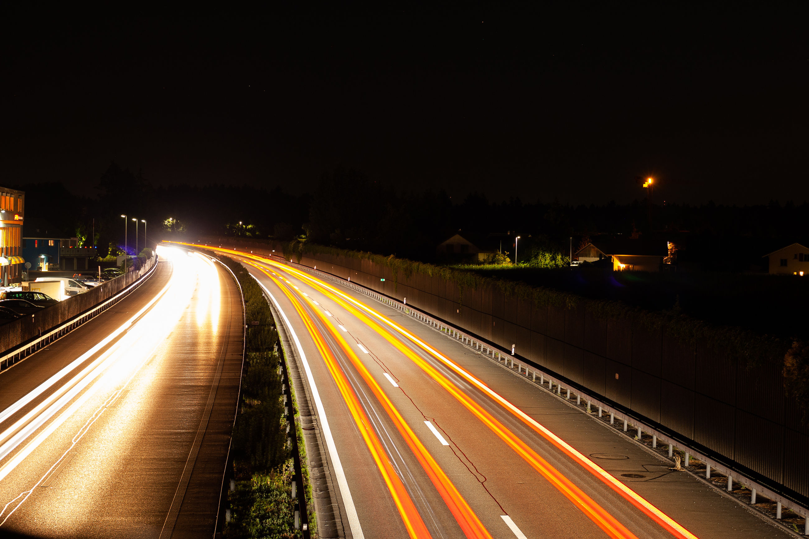 illuminated, long exposure, motion, light trail, night, road, transportation, speed, city, architecture, street, highway, no people, glowing, traffic, blurred motion, city life, street light, the way forward, sky, diminishing perspective, outdoors, multiple lane highway, vehicle light, light