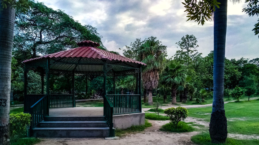 Tree Sky Architecture Cloud - Sky Built Structure Grass Domestic Garden Entrance Walkway Entryway Courtyard  Arched Woods Gate Entry The Still Life Photographer - 2018 EyeEm Awards The Architect - 2018 EyeEm Awards Humanity Meets Technology