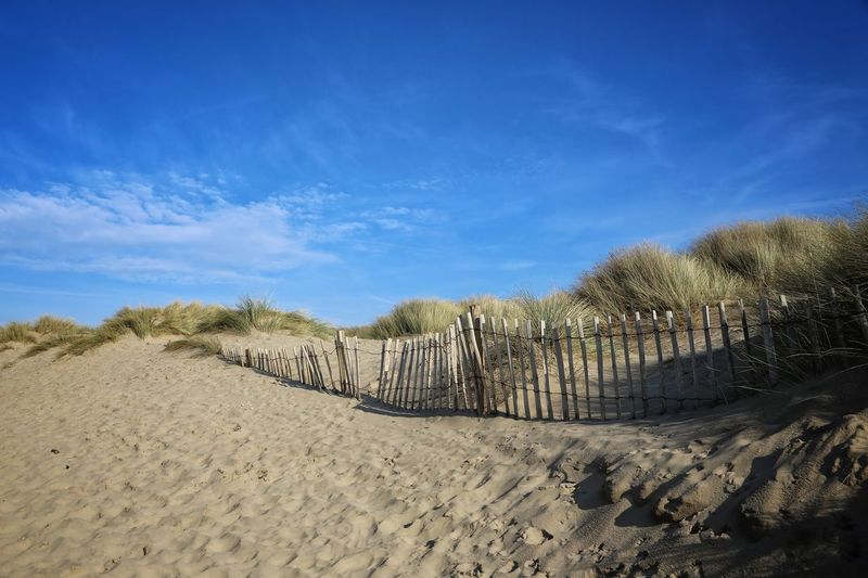 Formsby Beach Liverpool Formsby Beach Sand Sky Land Scenics - Nature Beach Blue Tranquility Tranquil Scene Cloud - Sky Nature No People Beauty In Nature Day Sunlight Non-urban Scene Environment Desert Landscape Barrier Fence Outdoors Arid Climate Climate