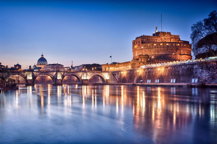 Castel Sant'Angelo, Rome, Italy Castel Sant'Angelo Roma Arch Arch Bridge Architecture Bridge Bridge - Man Made Structure Building Building Exterior Built Structure City Connection Dusk Government History Illuminated No People Outdoors Reflection River Sant'angelo Sky The Past Travel Destinations Water Waterfront