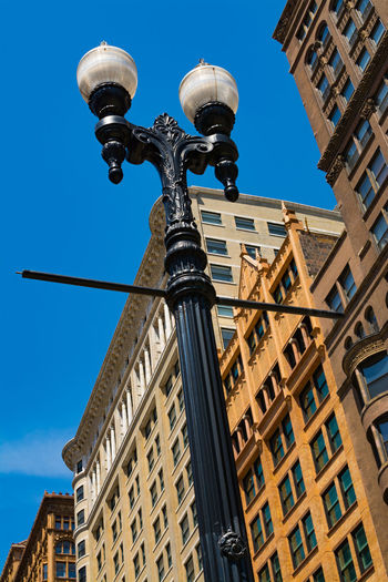 Old fashioned lamppost with downtown architecture in background. Chicago, Illinois, USA. Abstract America Backgrounds Building Chicago Cityscape Colors Concept Downtown Downtown District Exterior History Illinois Lamppost Light Nobody Nobody Around Old Sky Street Sunny Unoted States Vintage Window