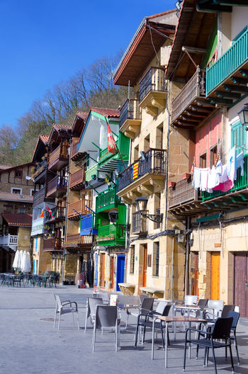 Colorful street and view of the main plaza in Donibane, Spain Basque Country Donibane Downtown Euskadi Façade Harbor Pasai Donibane - Euskalherria Rural SPAIN Architecture Building Built Structure Chair City Colorful Mountain Multicolored Old Outdoors Pasaia Plaza Residential District Town Urban Village