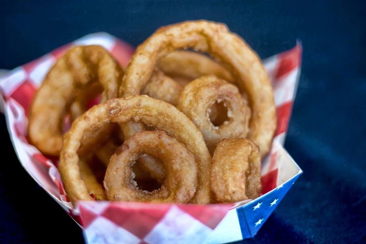 Close-up of onion rings in paper plate on table