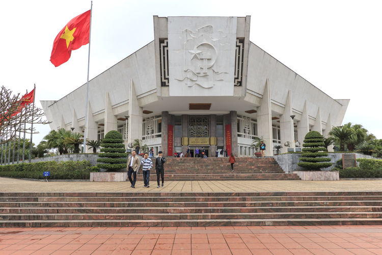 Hanoi, Vietnam - February 23, 2016: Tourists walking around the Ho Chi Minh Museum in Hanoi, Vietnam. Architecture Art Built Structure City City Life Day Façade Hanoi Hanoi Vietnam  Ho Chi Minh Mausoleum Lifestyles Old Town One Pillar Pagoda Outdoors Sky Tourists Travel Destinations Vietnam