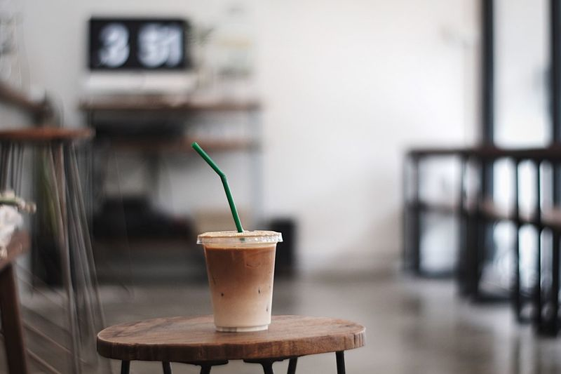 Coffee Chilling Coffee Break Lattemacchiato Coffee - Drink Coffee Focus On Foreground Drinking Straw No People Close-up Straw Food And Drink Drink Refreshment Potted Plant Wood - Material Day Indoors  Drinking Glass Freshness Table Cup Still Life Small Glass