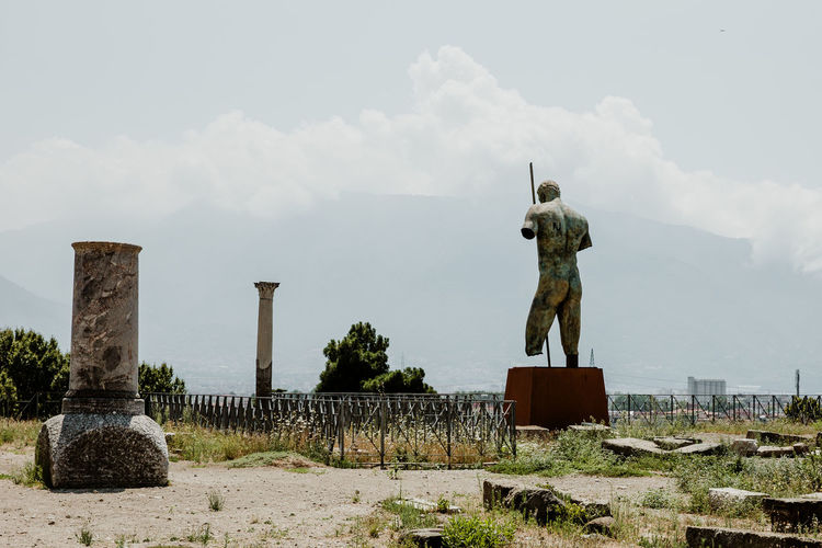 Sky Art And Craft Representation Sculpture Statue Cloud - Sky Architecture Nature Creativity The Past History No People Human Representation Memorial Built Structure Religion Craft Outdoors Male Likeness Architectural Column Pompeii  Ruins Ruins Architecture Pompeii Ruins Italy