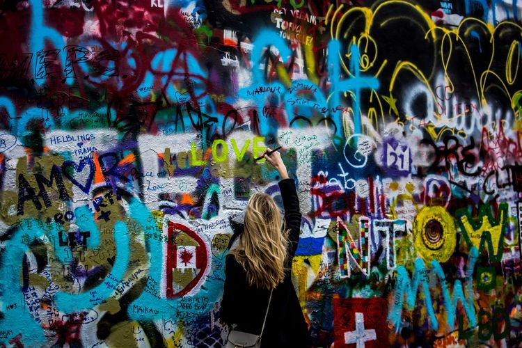 At the John Lennon Wall in Prague Art Art And Craft Creativity Everybodystreet Eye4photography  EyeEm Best Shots EyeEmBestPics Graffiti Graffiti Graffiti Art Graffiti Wall John Lennon Lennonwall Nikon Nikonphotography People People Photography People Watching Peoplephotography Street Street Photography Streetphotography Taking Photos Taking Pictures Wall - Building Feature