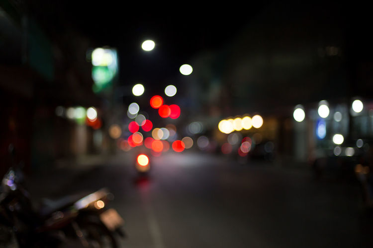 Architecture Background Bokeh Car City City Life City Street Defocused Headlight Illuminated Land Vehicle Light Lighting Equipment Mode Of Transportation Motion Motor Vehicle Night Nightlife No People Outdoors Road Street Street Light Traffic Transportation Vehicle Light