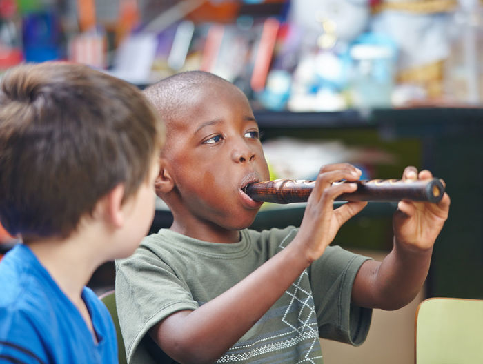Boy playing musical instrument