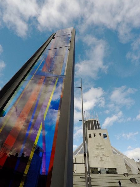 Metropolitan Cathedral Of Christ The King... Paddy's Wigwam Liverpool Building Building Exterior Built Structure Listed Building Liverpool Architecture Church Catholic Christ The King Cathedral Sky Flag Multi Colored Cloud - Sky Day Low Angle View Architecture Built Structure Outdoors