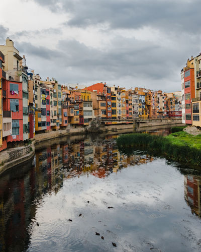 Girona Reflection Apartment Architecture Building Building Exterior Built Structure City Cloud - Sky Day Multi Colored Nature No People Outdoors Reflection Residential District River Sky Storm Cloud Transportation Water Waterfront