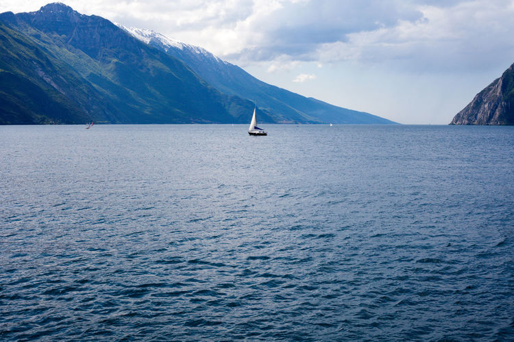 Sailing ship on Lake Garda in northern Italy Alps Copy Space Gardasee Idyllic Scenery International Landmark Italian Alps Lake Lake Garda Landmark Landscape Northern Italy Sailing Sailing Boat Sailing Ship Text Space Travel Destinations Trentino  Water Surface My Favorite Place
