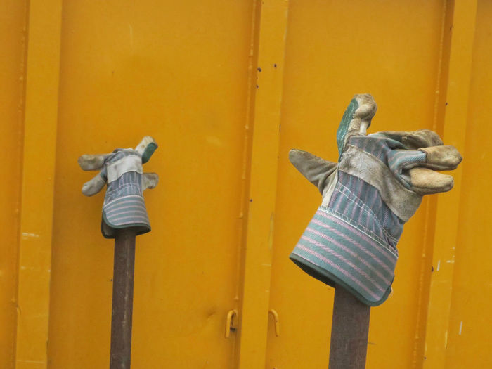 pair of working gloves Container Day Door Gloves Handle Metal No People Outdoors Protection Security Working Gloves Yellow