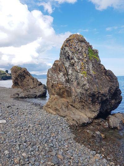 rock formation and black sand on the Coromandel peninsula, NZ Coromandel Peninsula New Zealand Geology Nature Ocean Coastline Coast Nzscenery Cliff Sky Cloud - Sky