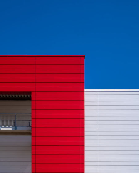Blueskybuildingdetail Architecture Blue Built Structure No People Fujix_berlin Ralfpollack_fotografie Minimalism Minimal Building Exterior Red Sky Building Copy Space Day Clear Sky Wall - Building Feature Industry Sunlight Outdoors Pattern City