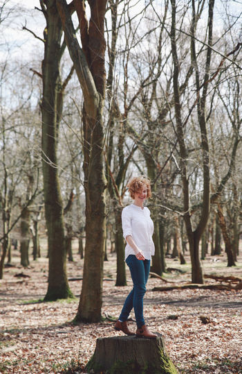 Bare Tree Beauty In Nature Blonde Casual Clothing Curly Hair Forest Full Length Fun Girl Growth Leisure Activity Lifestyles London Nature Outdoors Rear View Richmond Park, London Spring Tranquil Scene Tranquility Tree Tree Trunk White Shirt WoodLand Natural Light Portrait