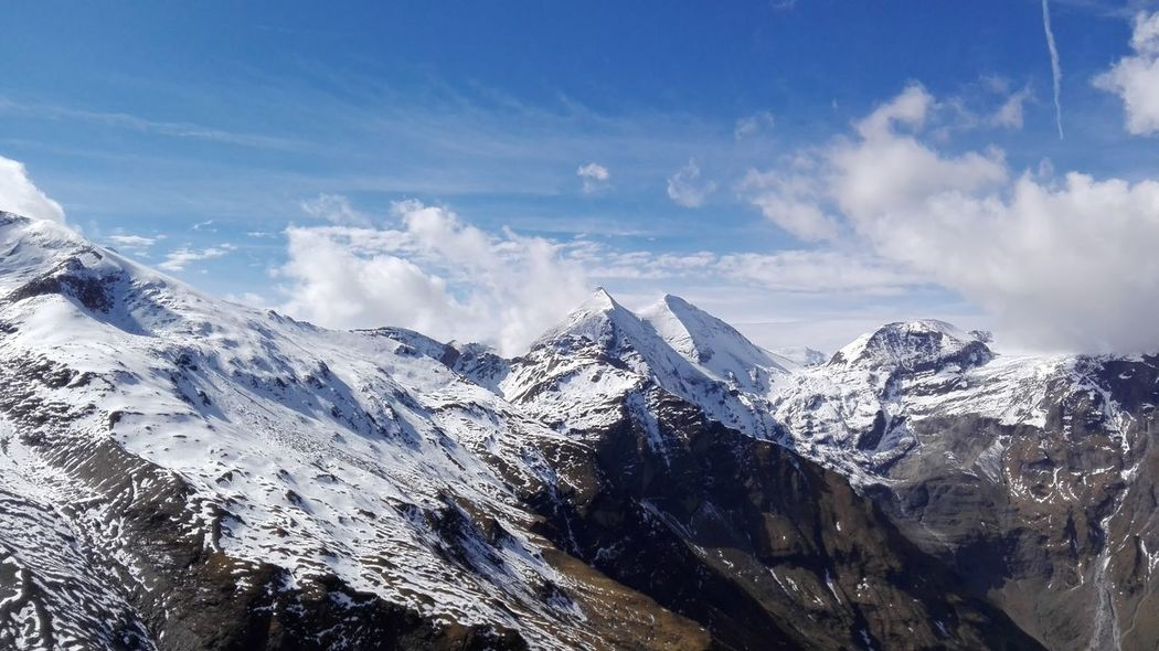 Austria Grossglockner Eyeem Selects Mountain Snow Mountain Range Winter Cloud - Sky Outdoors Snowcapped Mountain Mountain Peak No People Cold Temperature Sky Nature Day Pinaceae Landscape Scenics Beauty In Nature Forest Tree EyeEmNewHere An Eye For Travel Shades Of Winter