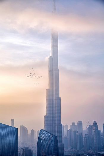 Morning Bliss Architecture Abstract Goldenhour Burjkhalifa Photooftheday Dubai Landscape_photography Building Exterior Built Structure Architecture City Sky Office Building Exterior Building Skyscraper Cloud - Sky Landscape Cityscape Urban Skyline Tower Nature Tall - High Modern Office Residential District No People