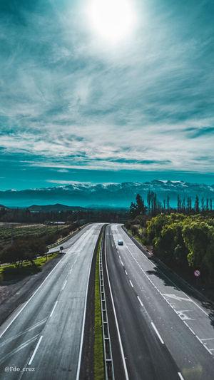 Highway against sky in city