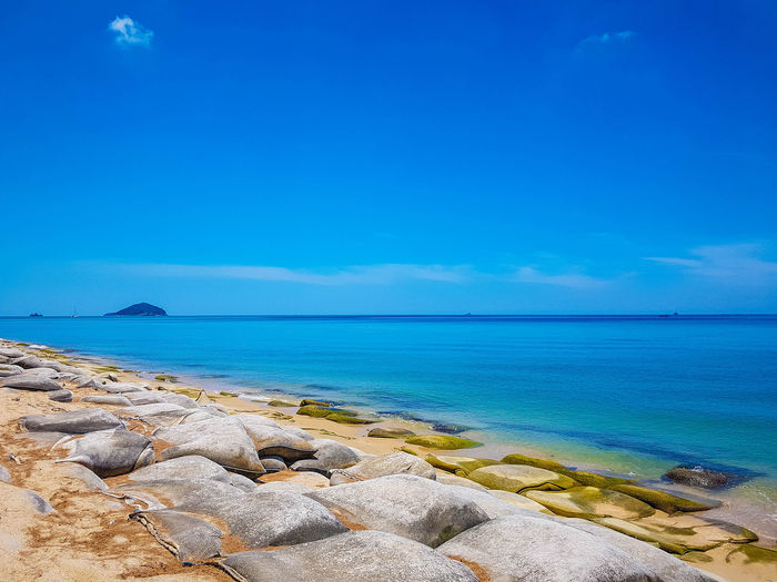 Bright Sunshine Samila Beach Songkhla Thailand Beach Beauty In Nature Blue Cloud - Sky Day Horizon Over Water Idyllic Land Nature No People Outdoors Rock Rock - Object Rocky Coastline Scenics - Nature Sea Sky Solid Tranquil Scene Tranquility Turquoise Colored Water