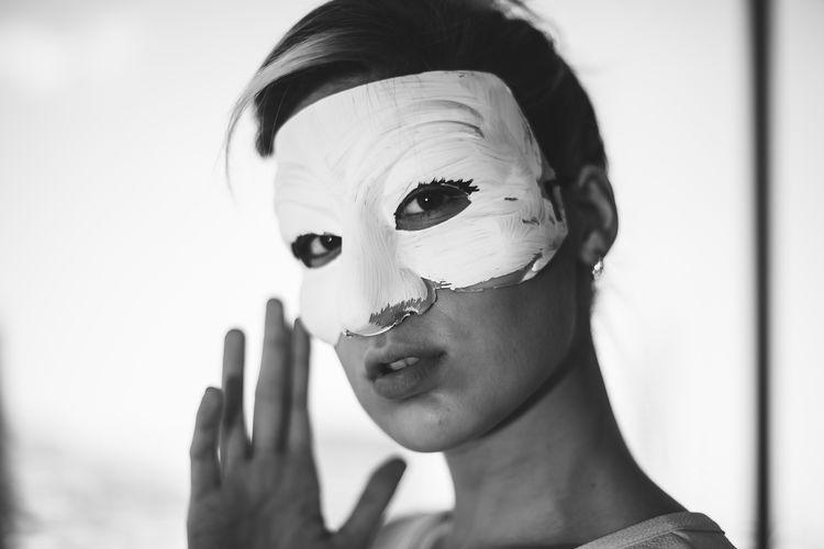 Close-up portrait of woman wearing eye mask