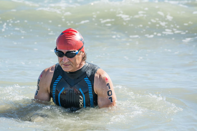 Pescara, Italy - June 18, 2017: Starting for the swimming test of disabled athlete Alex Zanardi at Ironman 70.3 Pescara of June 18, 2017 70.3 Alex Zanardi Athlete Competition Concentration Contest Disabled Editorial  Invalid  Ironman Italy Pescara Race Sport Sports Start Starting Swim Swimsuit Triathlete TRIATHLON Water Wetsuit Zanardi