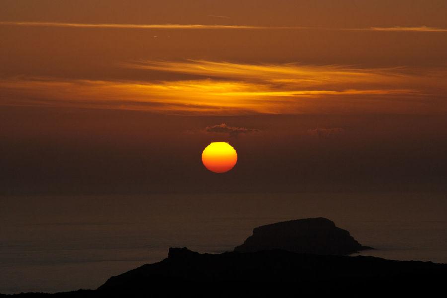 Sunset into Santorini caldera Beauty In Nature Cloud - Sky Idyllic Nature No People Orange Color Outdoors Scenics Sea And Sky Sky Sun Sunset Tranquil Scene Tranquility