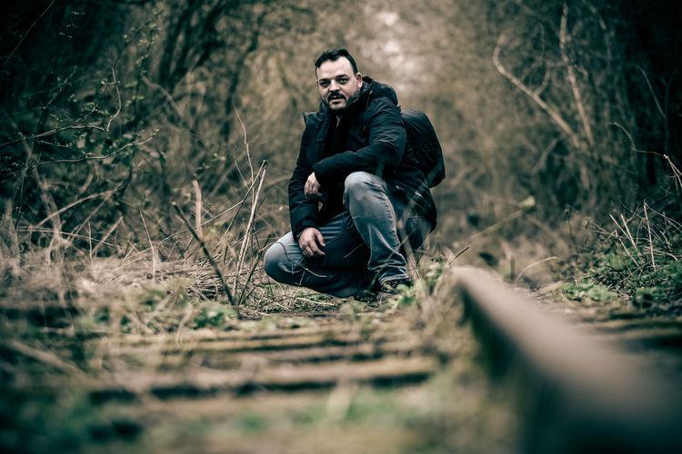 Man next to the railway