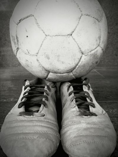 Football and boots Low Section Close-up Ball Outdoors Old Reuse Oldie  Perfect Shot EyeEm Best Shots Eyeemphotography Bestblackandwhitepics Boots Football Footwears Lieblingsteil