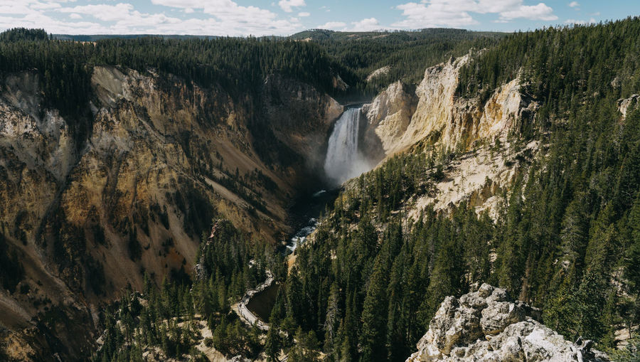 Yellowstone Yellowstone National Park Canyon Yellowstone Canyon Waterfall Blurred Motion Scenics - Nature Wyoming Wyoming Landscape Mountain Beauty In Nature Non-urban Scene Rock Us National Park Nature Environment Tranquil Scene Tranquility Mountain Range No People Landscape Rock - Object Day Land Tree Remote Outdoors Flowing Water Formation Water Power In Nature
