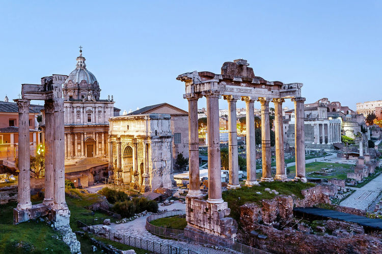 High angle view of roman forum against sky at sunset