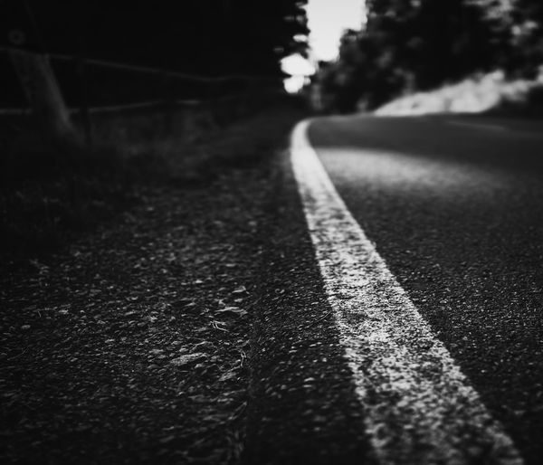 The way Forward Melancholic Road Thinking Asphalt Blackandwhite Blurry City Close-up Day Destination Diminishing Perspective Direction Dividing Line Empty Road Focus On Foreground Future Long Marking Nature No People Outdoors Road Road Marking Selective Focus Sign Street Surface Level Symbol The Way Forward Transportation Way