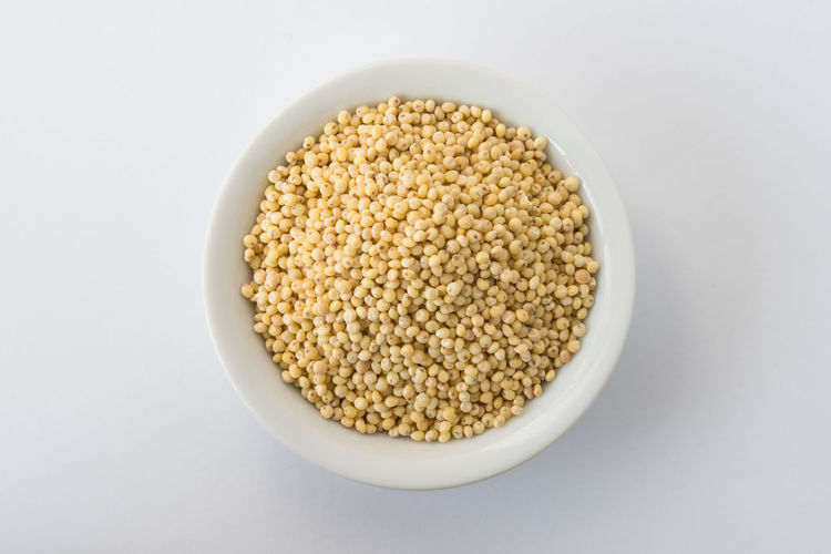 millet in a bowl Millet Food And Drink Food White Background Bowl Close-up Directly Above No People Ingredient Cereal Plant Fodder Macro Nobody Isolated