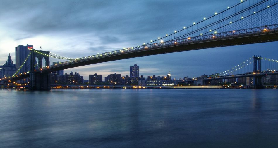 Soft as a mean tide. Manhattan via cool Brooklyn way!Battle Of The Cities Architecture Connection Bridge - Man Made Structure Suspension Bridge City Waterfront DuskUrban Skyline East River Manhattan Bridge Brooklyn Bridge In New York Slowshutterspeed Photography