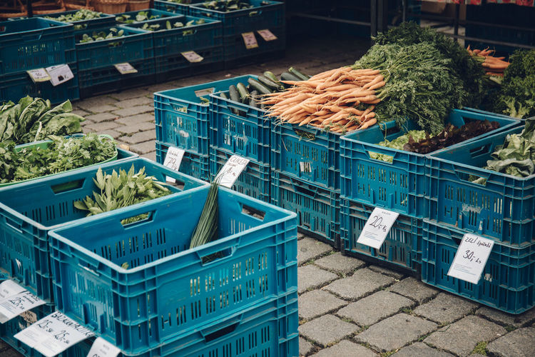 Vegetables in crate for sale at market stall