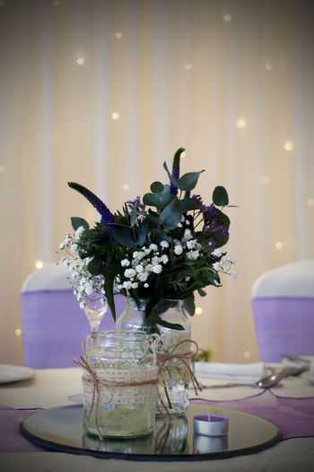 Bouquet Candle Close-up Day Flower Flower Head Focus On Foreground Freshness Illuminated Indoors  No People Purple Table Top Table Vase Wedding Wedding Reception