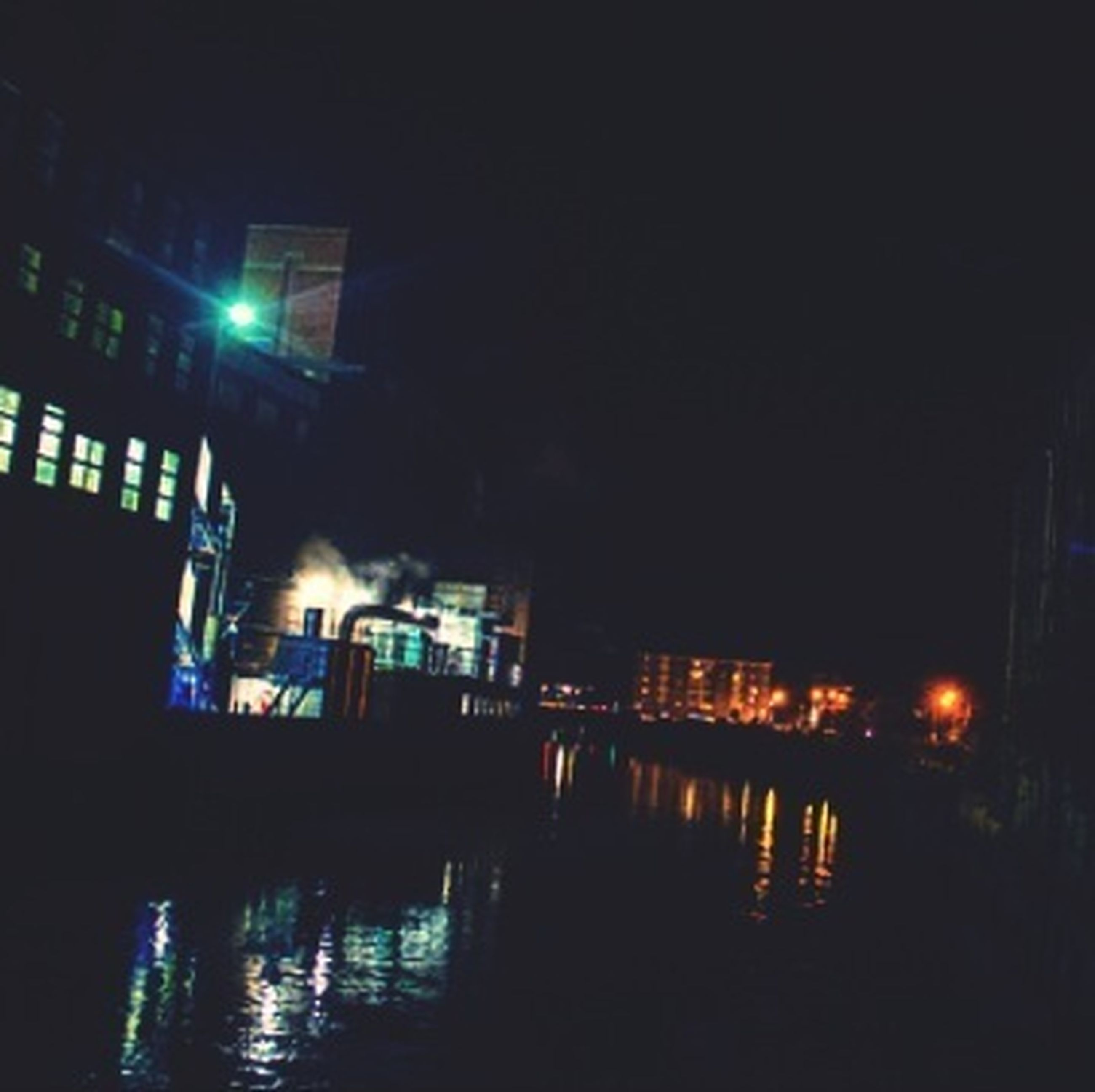 illuminated, night, building exterior, water, reflection, architecture, built structure, waterfront, city, river, sky, street light, building, lighting equipment, canal, residential building, residential structure, outdoors, dark, no people