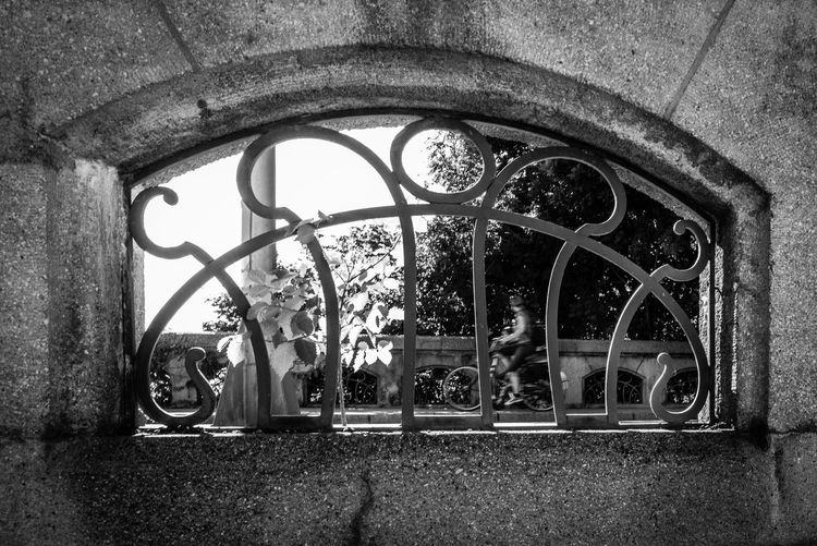 Architecture Built Structure No People Day Arch Building Building Exterior Metal Old Window History The Past Outdoors Wall Wall - Building Feature Nature Plant Geometric Shape Abandoned Wheel