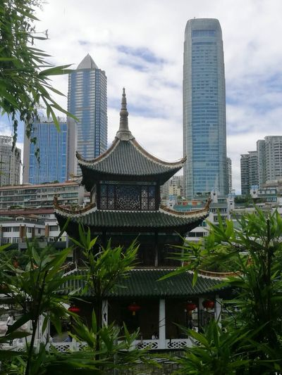 Architecture Travel Destinations Skyscraper City Tower Tourism Urban Skyline Built Structure Cityscape Travel Building Exterior Tree Cloud - Sky No People Outdoors Sky Modern Day Window View History Tradition Ancient Taking Photos Guiyang Guizhou